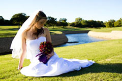 Bride on grassy field overlooking river